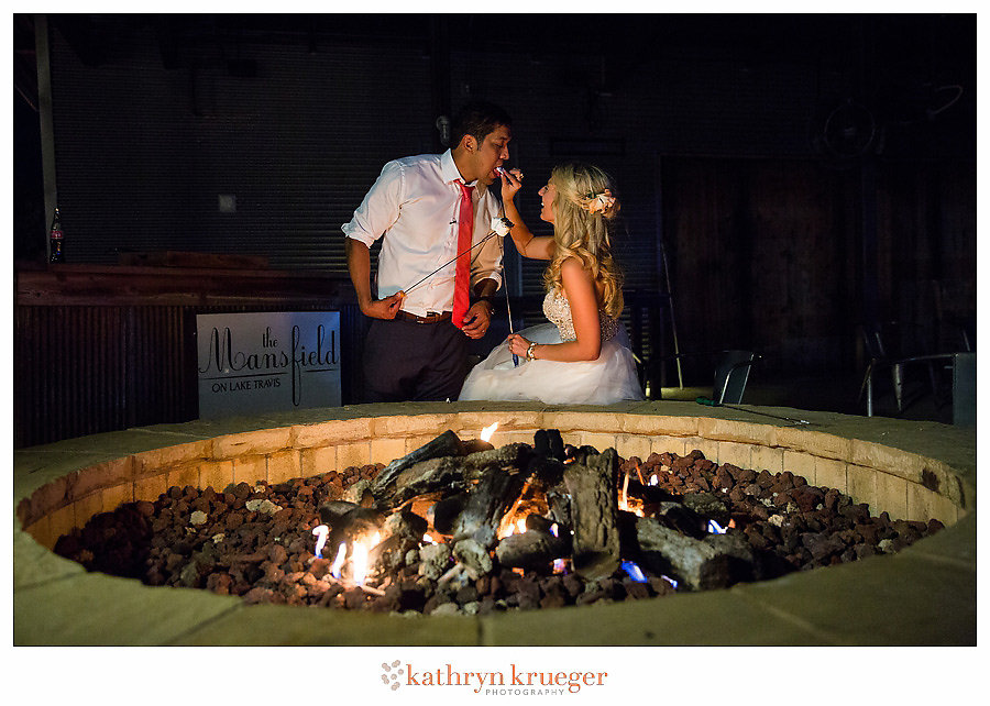 Bride and groom making smores