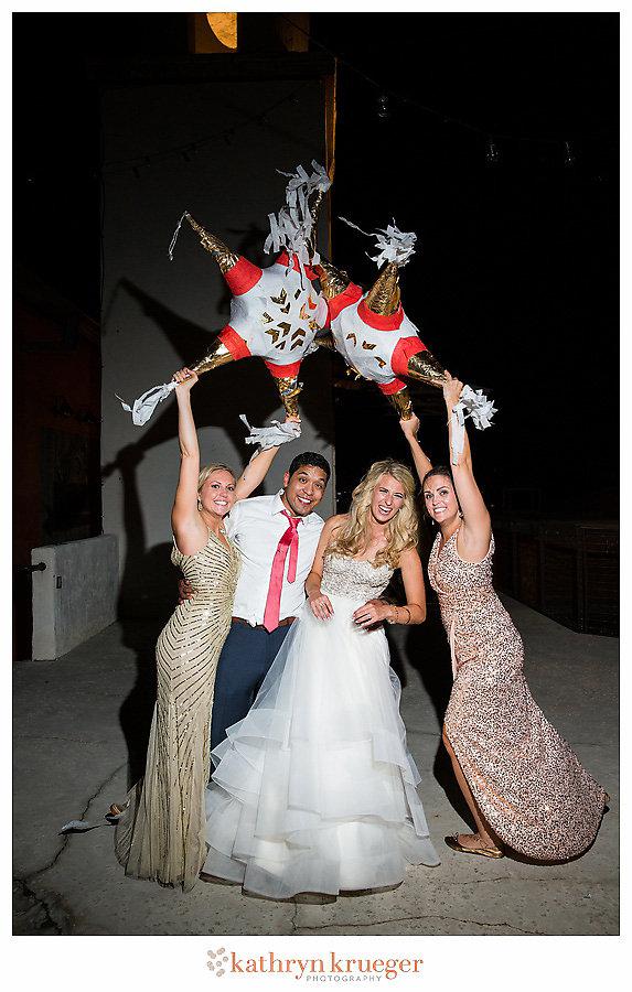 Bride groom bridesmaids with pinatas