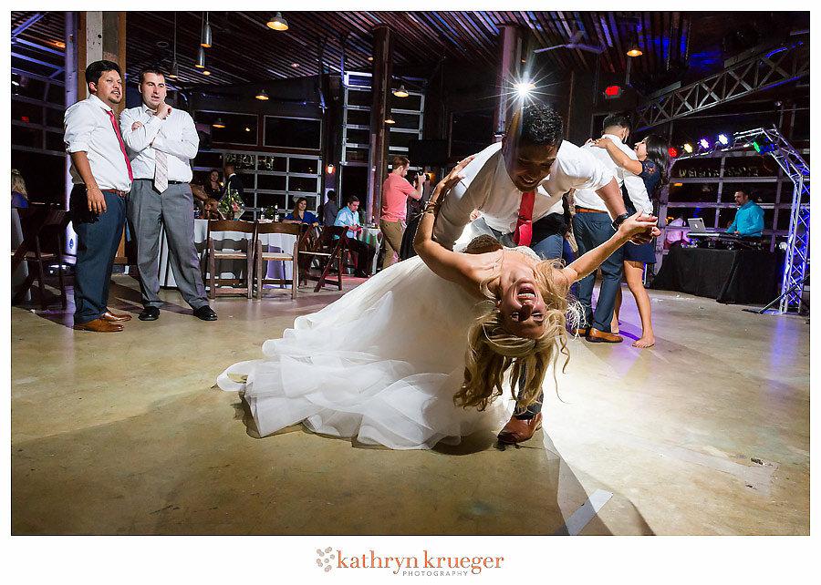 Bride & groom final dip while dancing