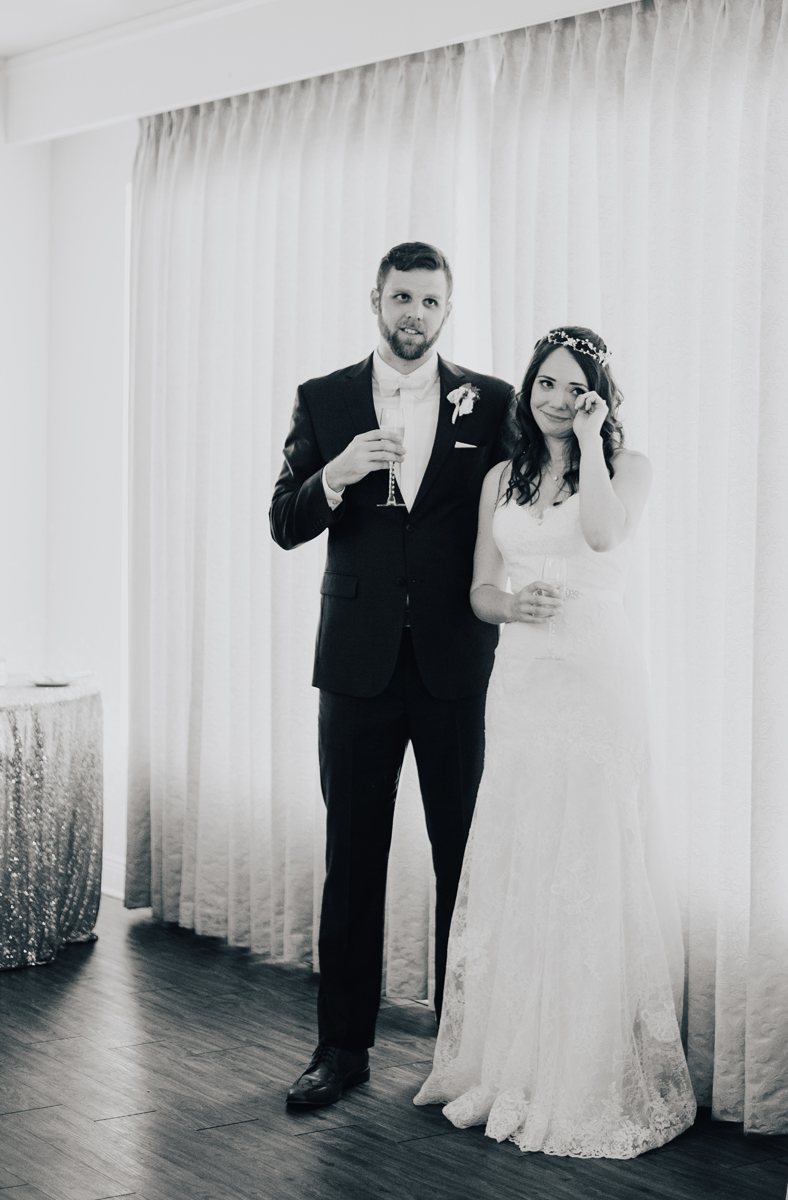 Bride and groom crying during toasts