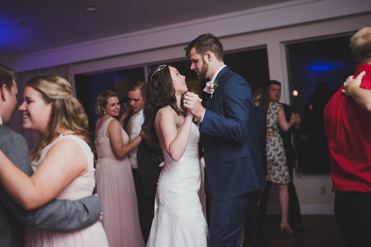 Bride and groom dancing and singing