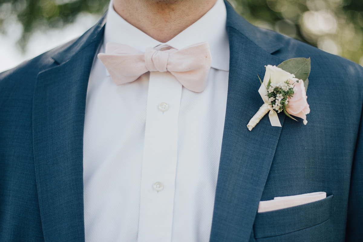 Groom navy suit pink bout