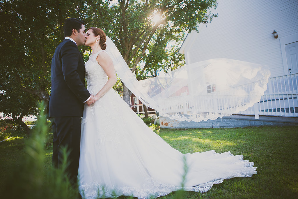 Bride & groom flying veil
