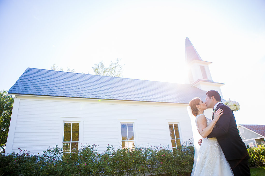Bride & groom kissing at Star Hill Ranch chapel