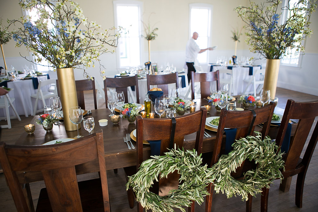 Star Hill Ranch head table wreaths on chairs