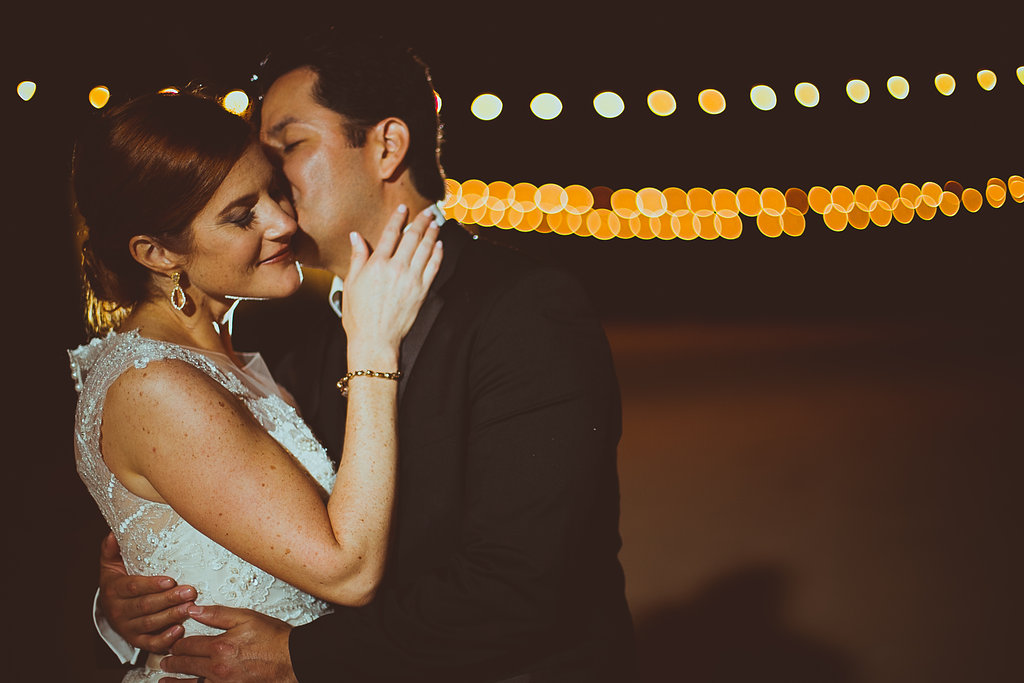 Bride & groom under cafe lights at Star Hill Ranch