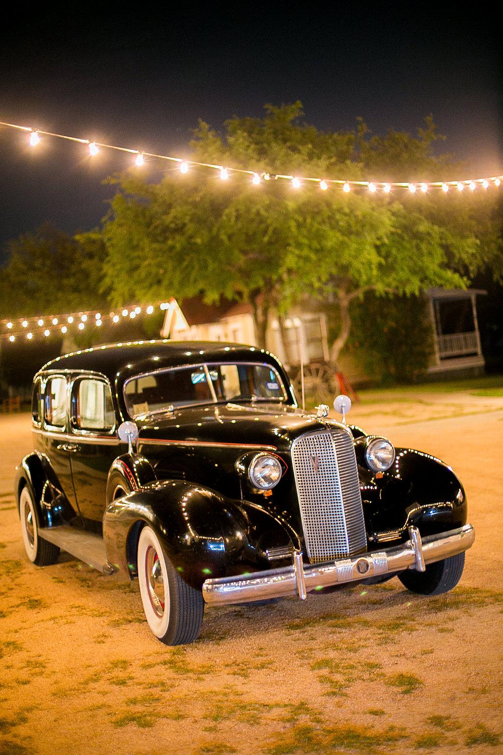 Vintage wedding getaway car 1937 black cadillac