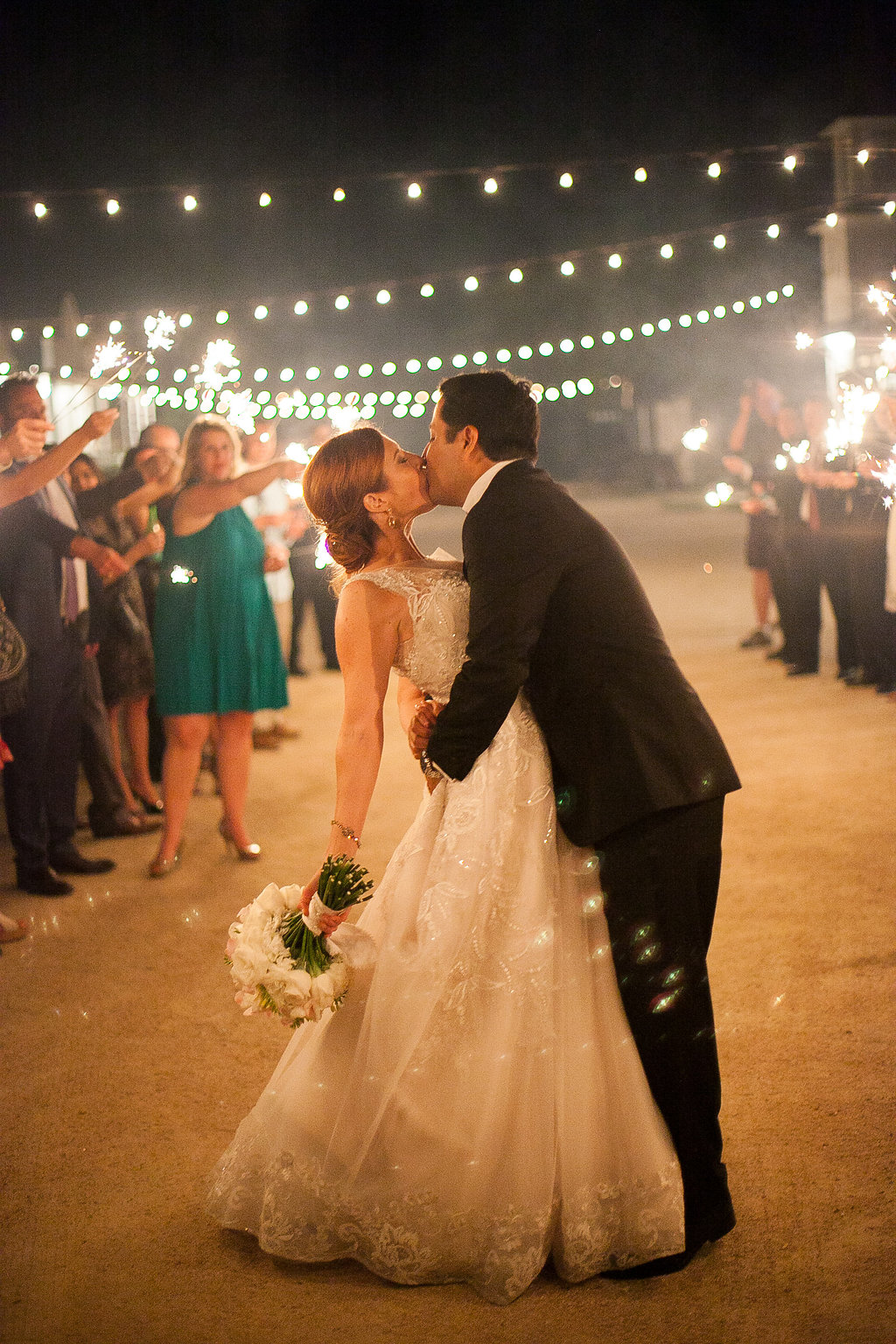 Wedding sparkler exit under cafe lights