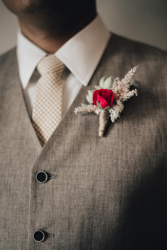 Red rose succulent boutonniere