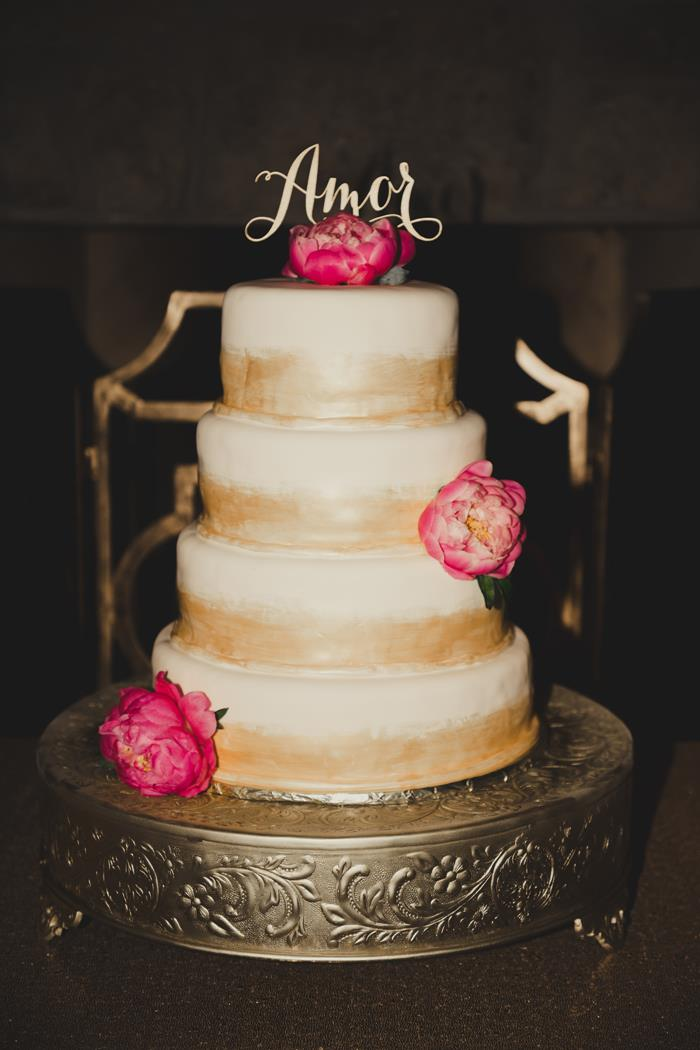 Gold painted cake with Amor cake topper