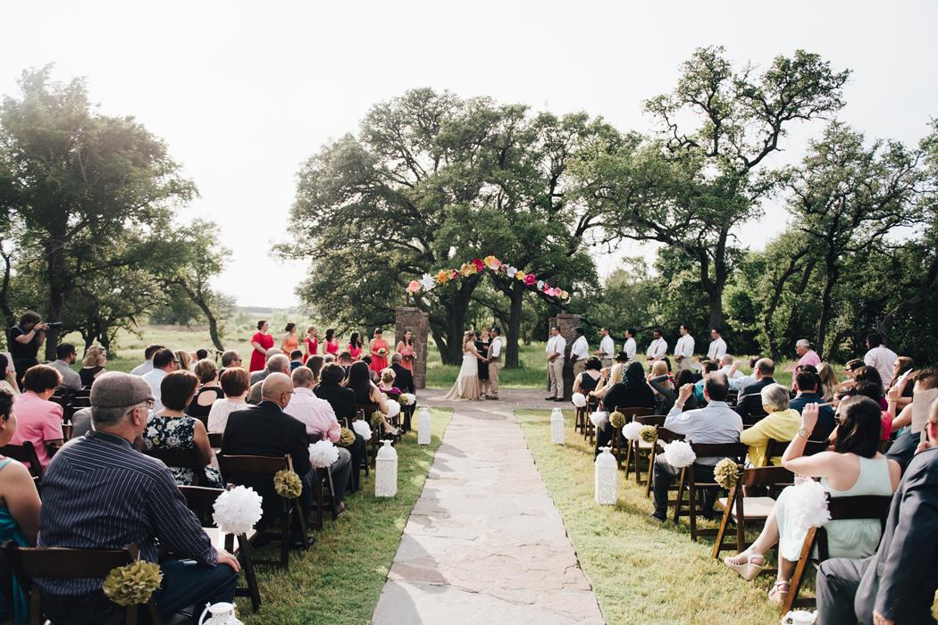 Ma Maison overall wedding ceremony under arch