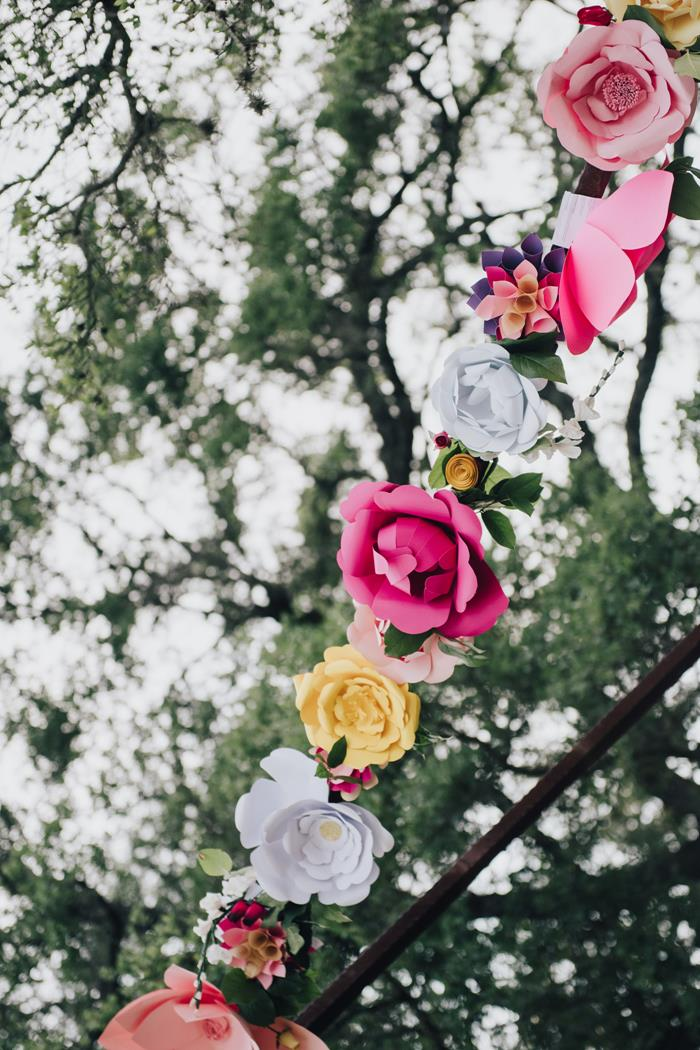 Closeup of paper flowers on arch