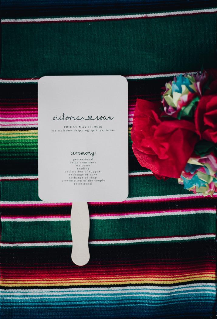 Fiesta wedding program fan on Mexican blanket