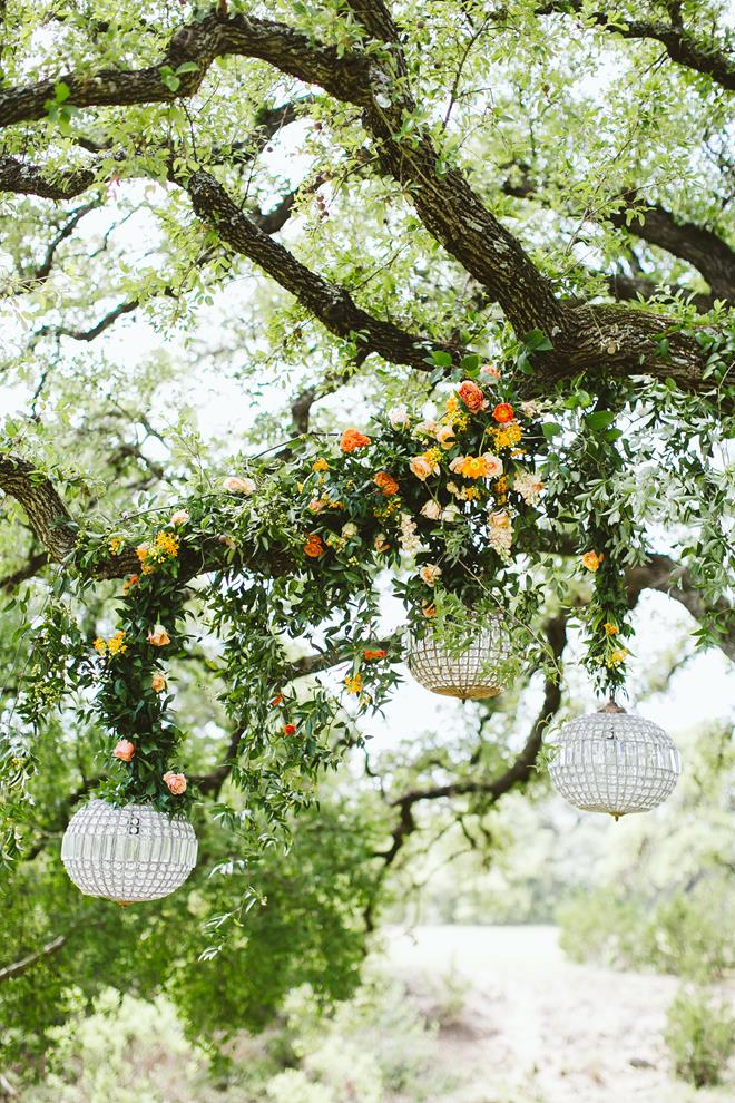 Brides of Austin styled shoot fresh fall boho greenery floral chandeliers in tree