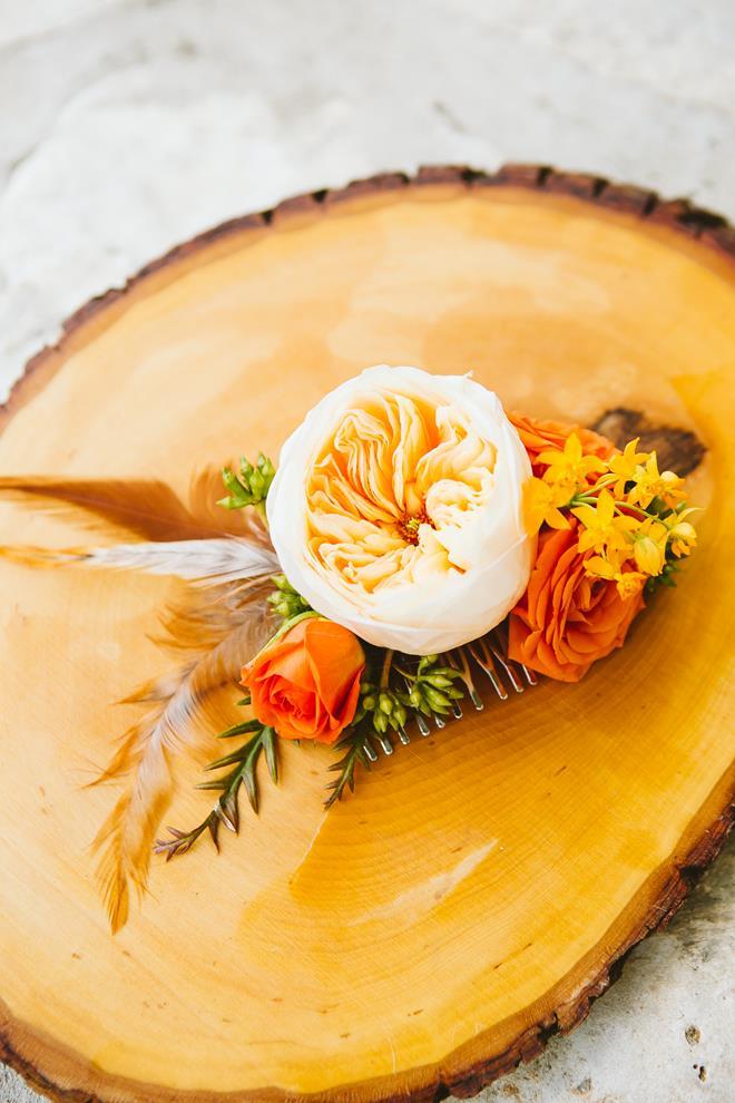 Peach orange green feathers bridal headpiece on wood slice