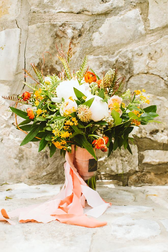 Peach orange green bridal bouquet tied with scarf