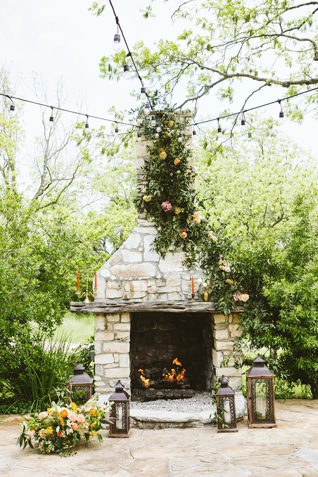 Pecan Springs Ranch fireplace ceremony setup with lanterns
