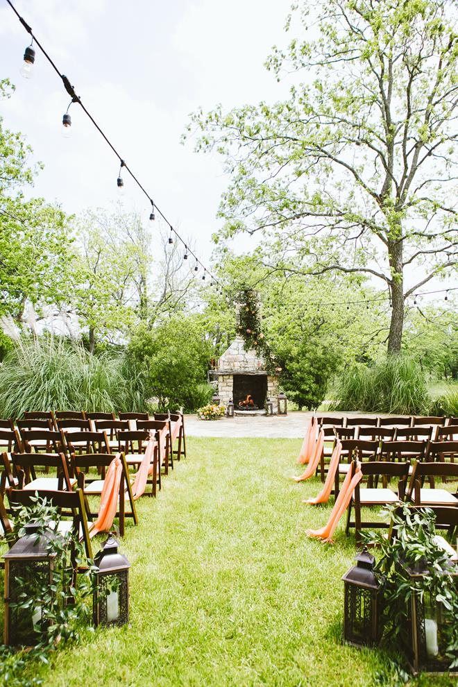 Pecan Springs Ranch fireplace ceremony setup; cafe lights