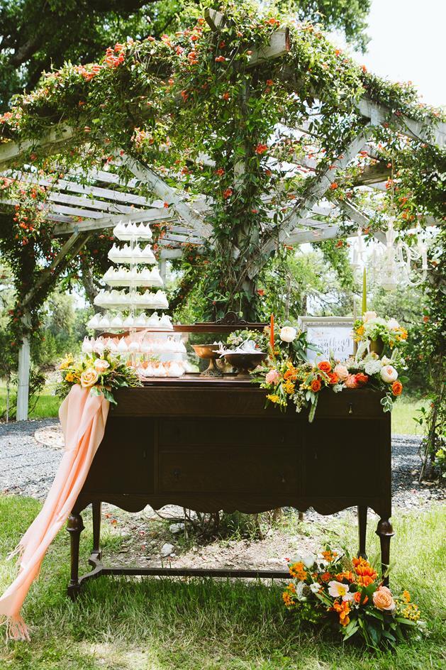 Wedding meringue tower on vintage buffet
