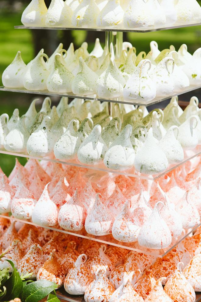Peach orange green wedding meringue tower at Pecan Springs Ranch