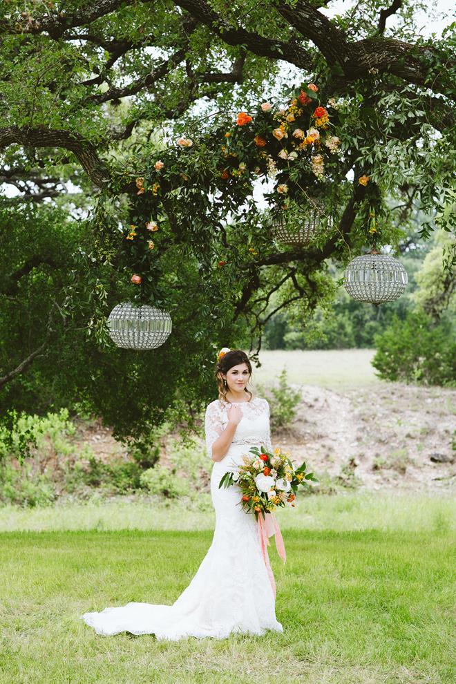 Bride under chandelier arch at Pecan Springs Ranch