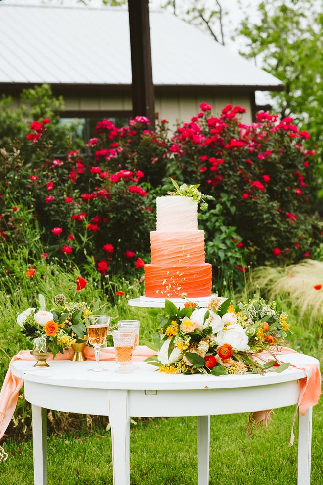 Pecan Springs Ranch cake table orange ombre