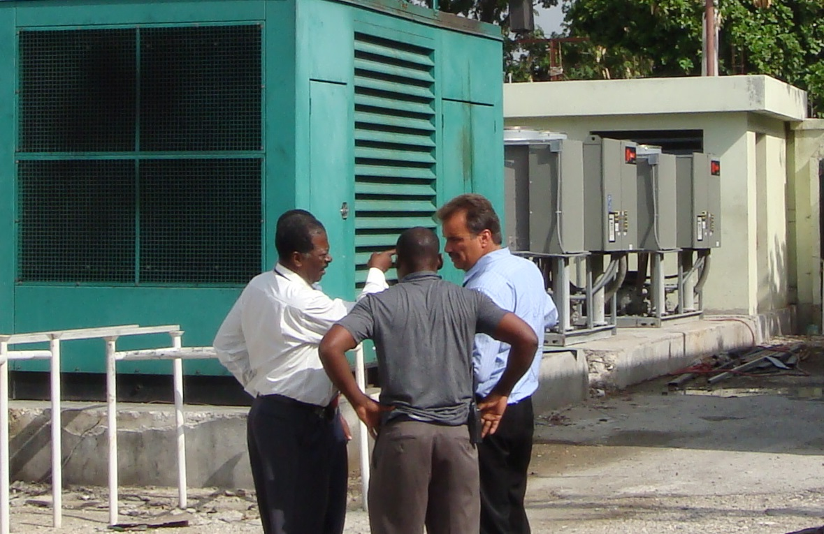 (AAN) Autorite Aeroportuaire Nationale Director General (Haiti) Lionel Isaac (far left) reviewing airport power plan repairs and 3 MW solar field design & placement for the Port Au Prince Airport