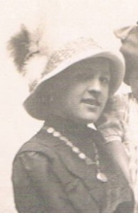 A Victorian Lady wearing a necklace featuring her collection of Love Tokens.