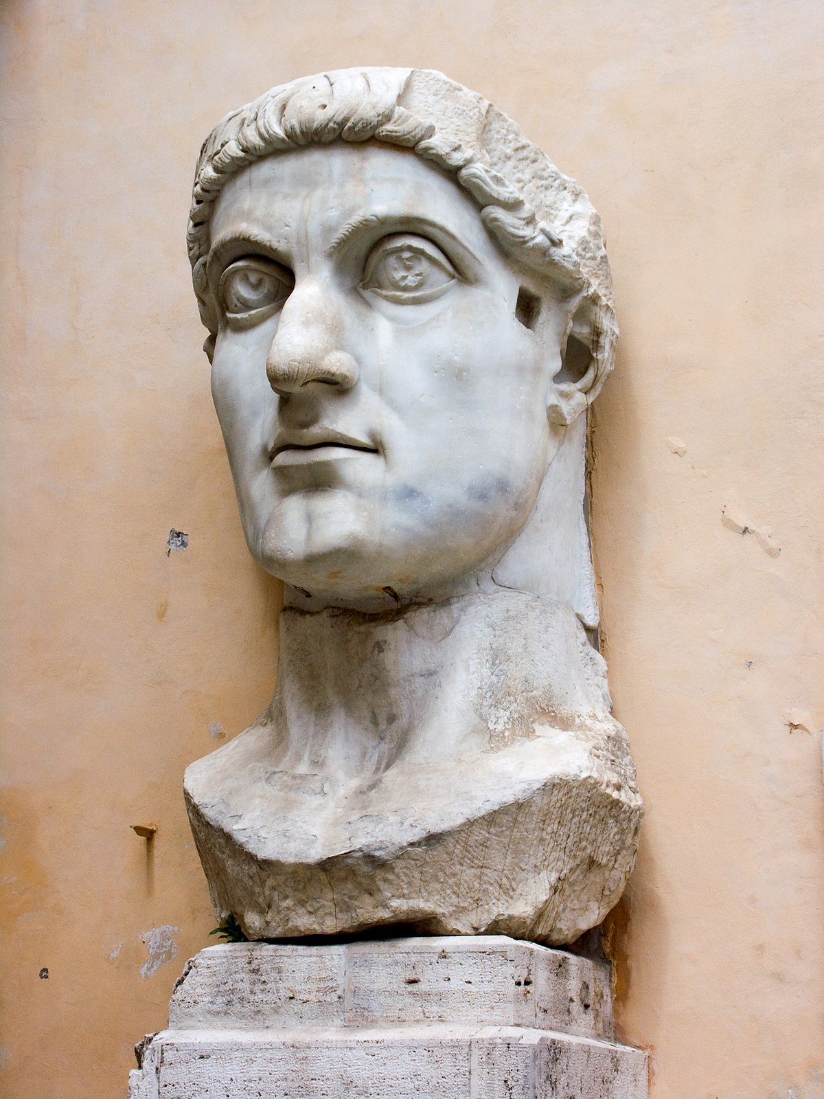 The head of a former colossal statue of Constantine at the    Capitoline Museums   , measuring more than 2 meters; the original statue of marble was acrolithic with the torso consisting of a cuirass in bronze