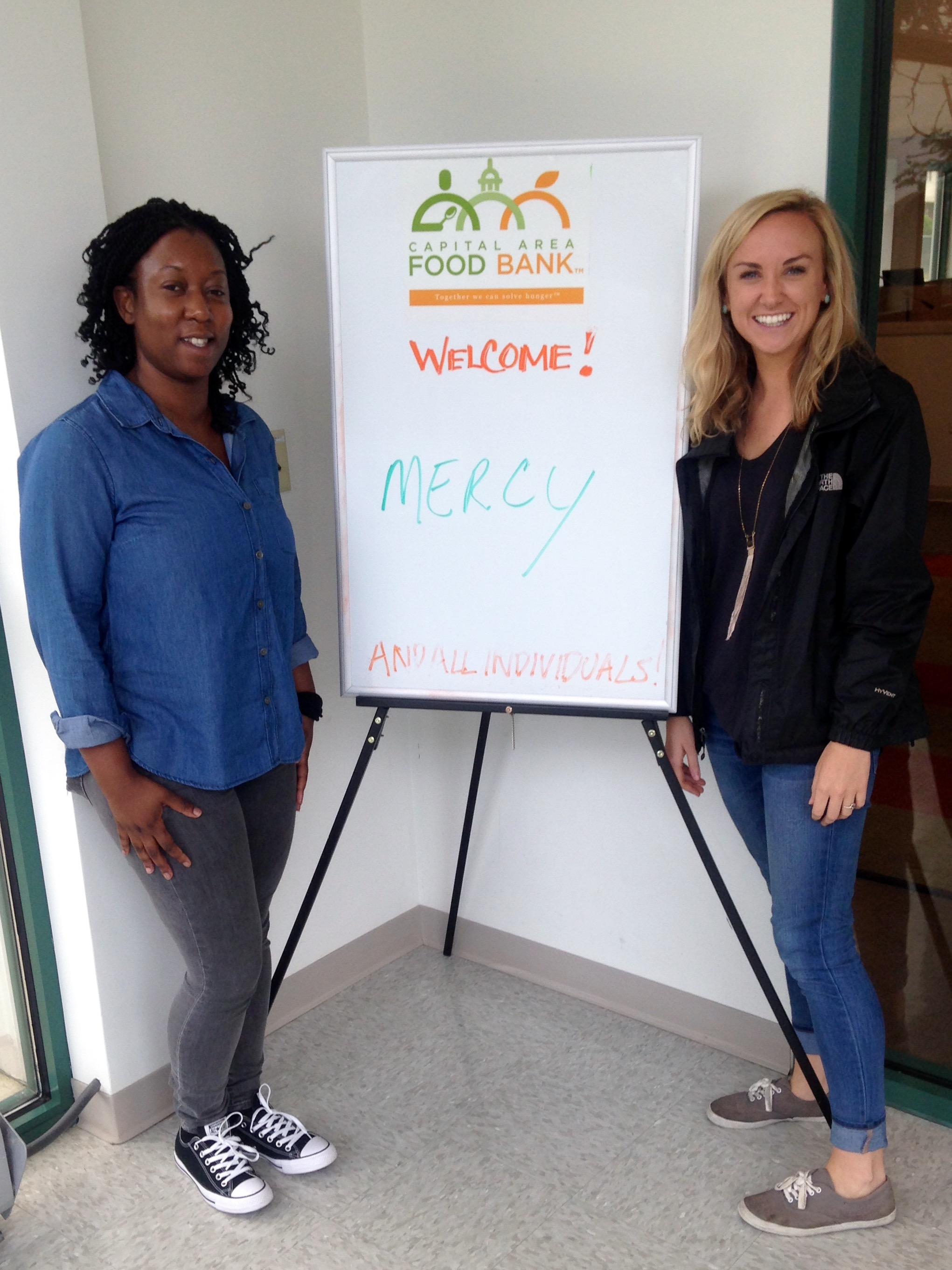Our DC team, Mercy and Casey, at their Day of Service at Capital City Food Bank