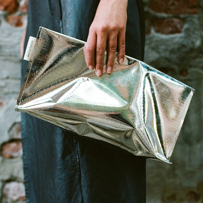CLIENT: laFortuna  PROJECT: Silver Clutch PROCESS: Die Cutting and Scoring, Sewing PHOTO CREDIT: Nora Lowinsky