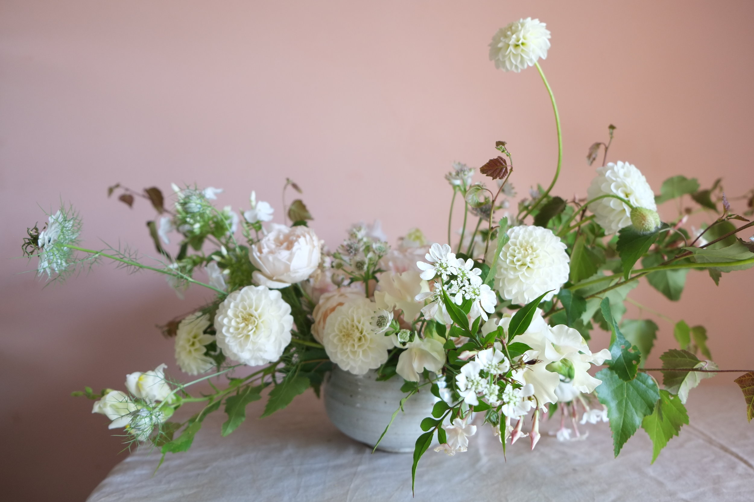 July wedding table inspiration with low bowl arrangement.