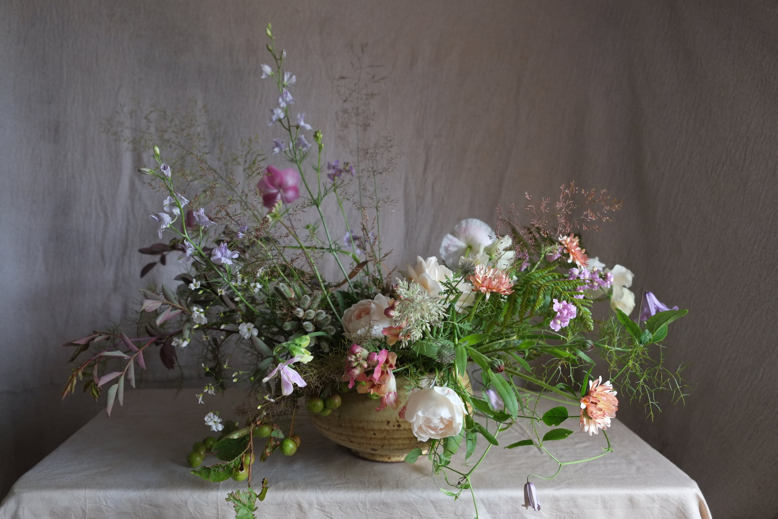 July inspiration for wedding flowers on tables.