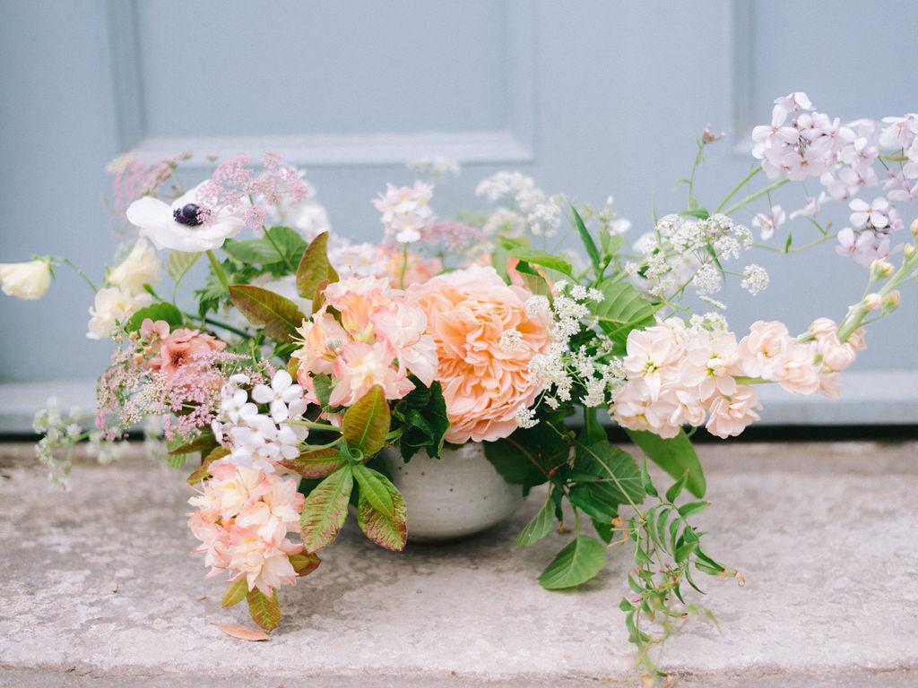 Seasonal flowers in Leach Pottery bowl for reception flowers