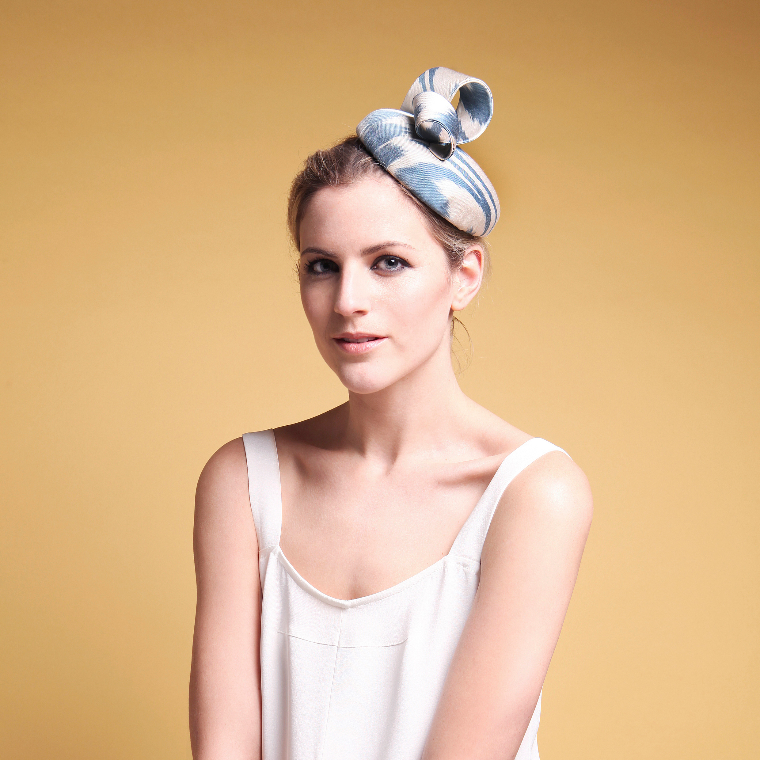 OCTAVIA - £75  Blue and White silk button headpiece with coordinating twist.