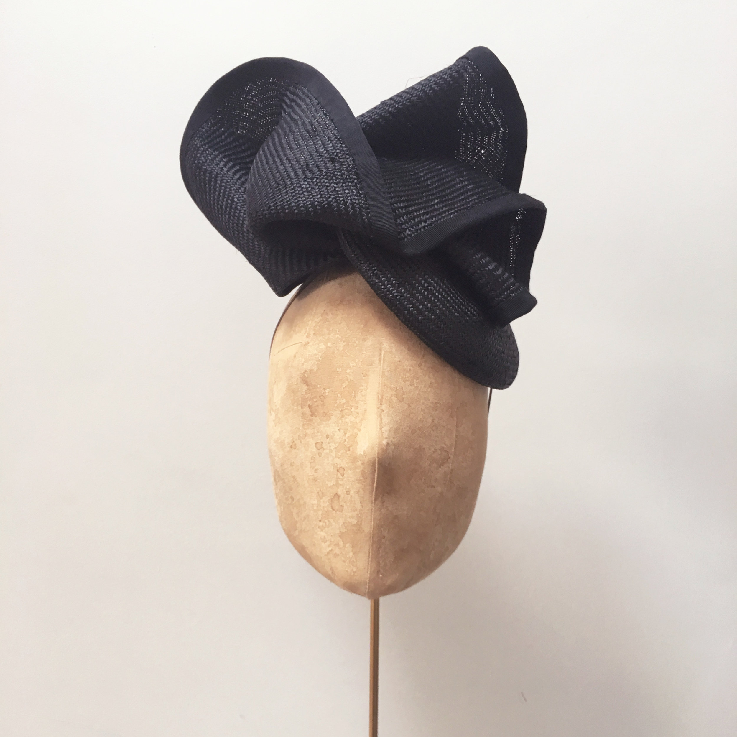 HELIX - £70  Black sisal straw button headpiece with matching structural folds.