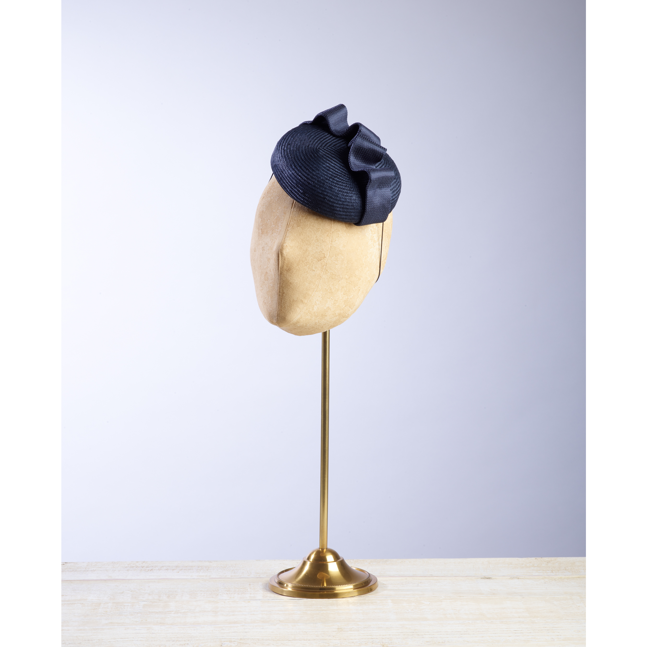 ARCH (Navy) - £60  Navy sisal straw button headpiece with matching navy fabric wave.