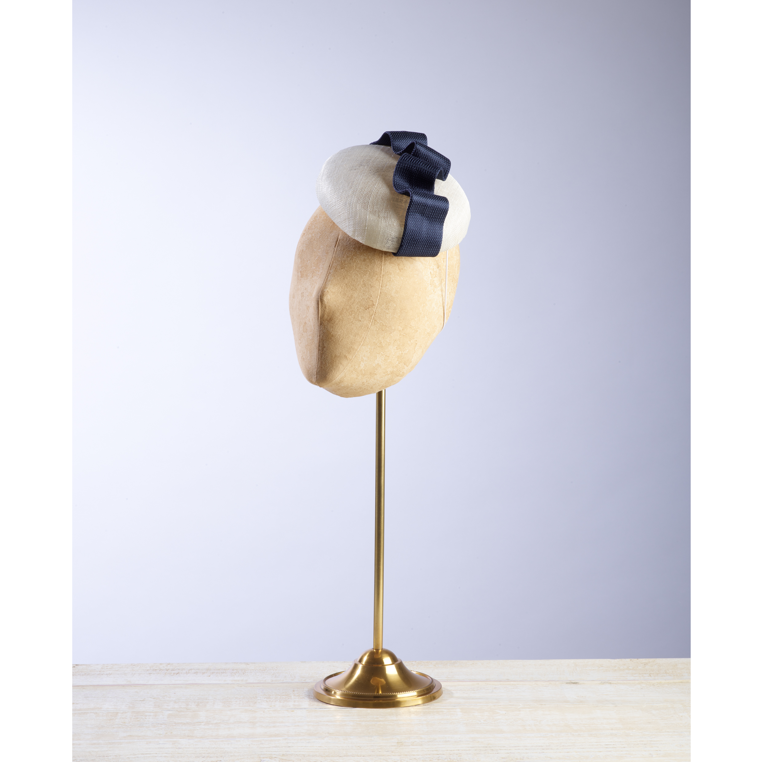 ARCH (White/Navy) - £60  Cream pinokpok button headpiece with contrasting navy fabric wave.