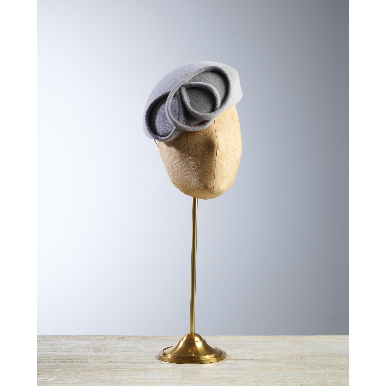 CRINOLETTE - £70  Dove grey peachbloom felt oval headpiece with loop detail.