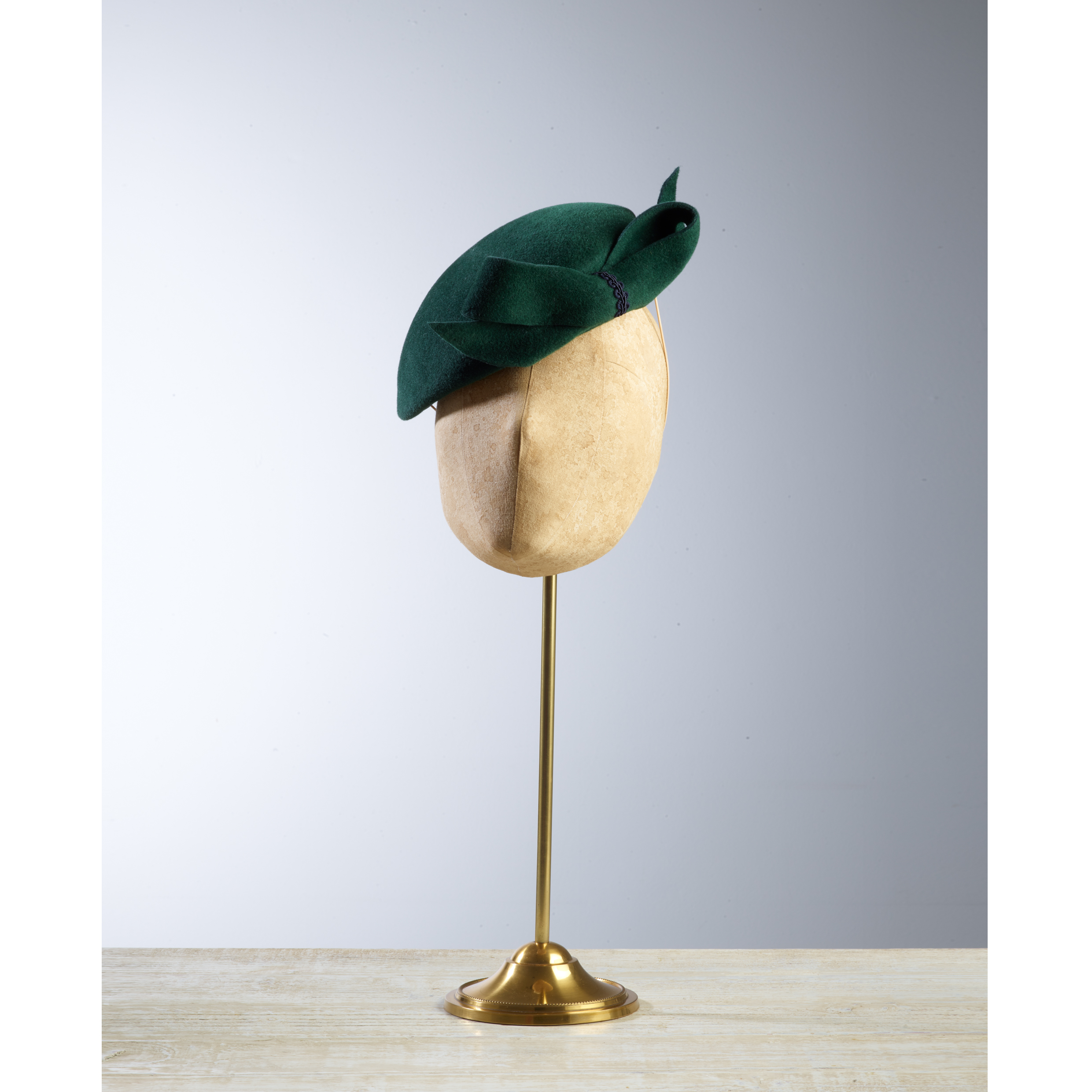 DART Emerald - £75  Emerald peachbloom felt oval headpiece, finished with a bow on the front.