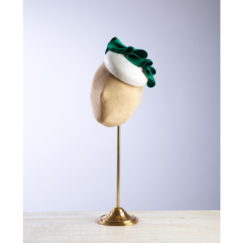 RAKE - £65  Cream sisal straw button headpiece with emerald green pleated folds.