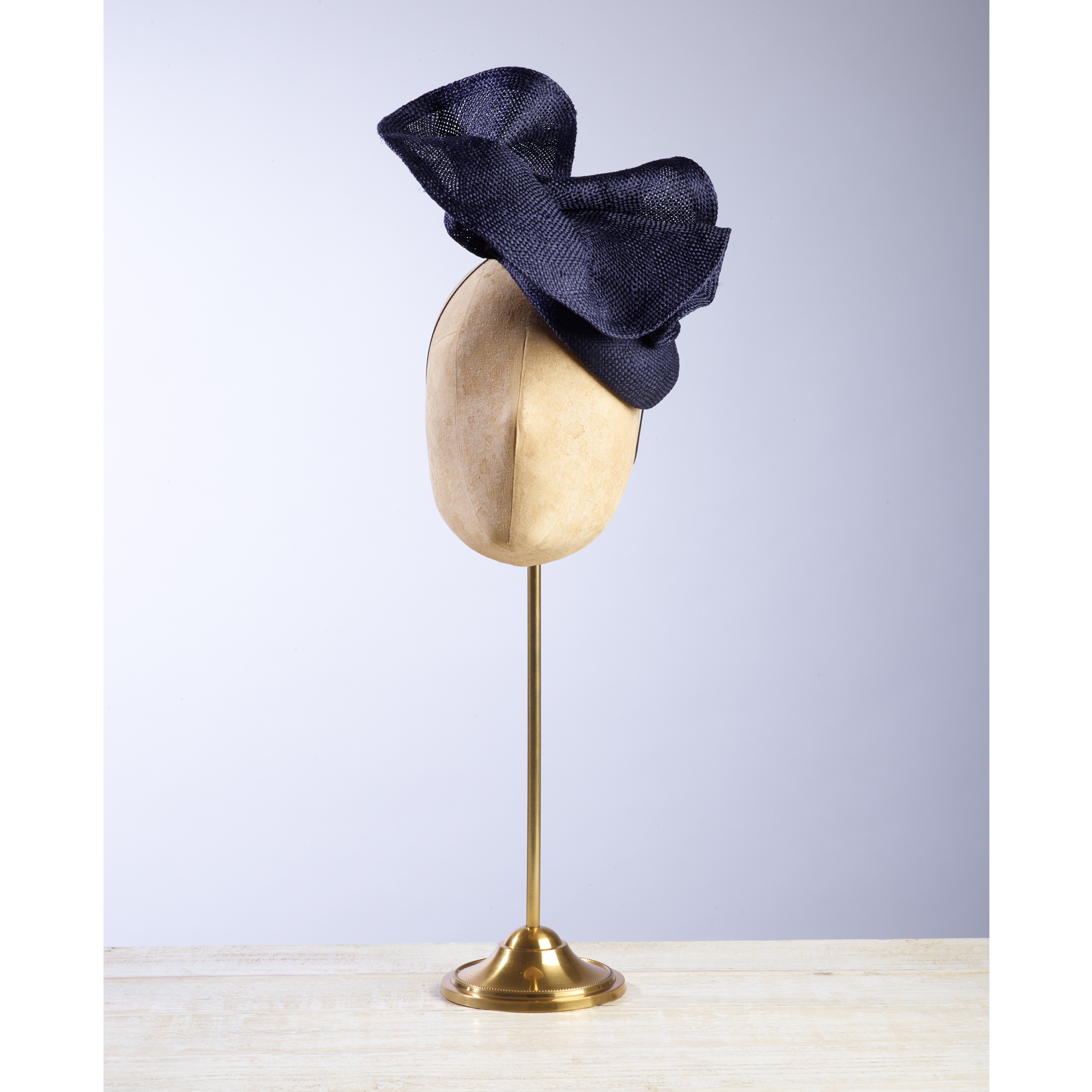 VOLUTE (Navy) - £80  Navy sisal straw button headpiece with matching structural folds.