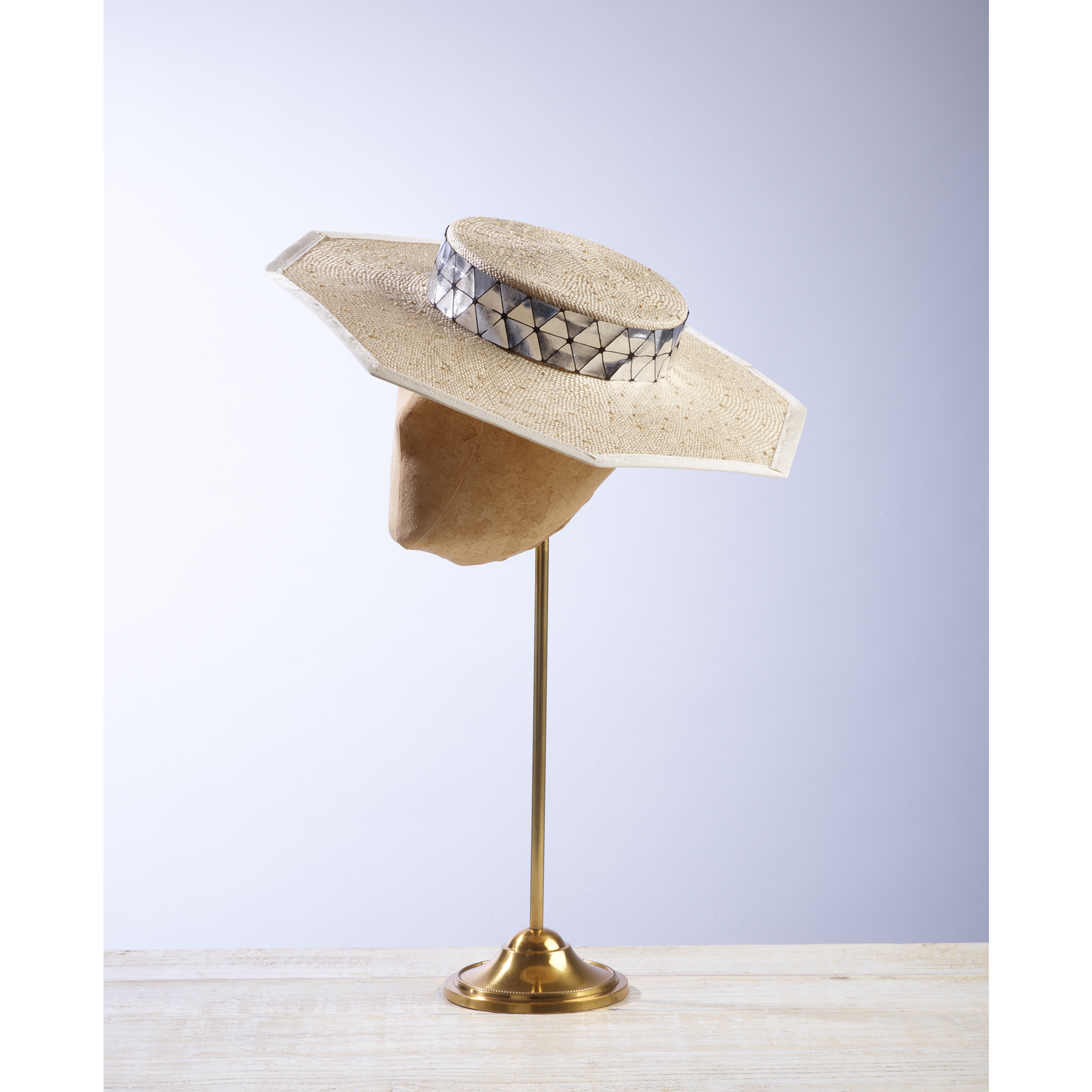 COFFER - £80  Cream knotted sisal straw octagon boater with silver and black diamond trim.