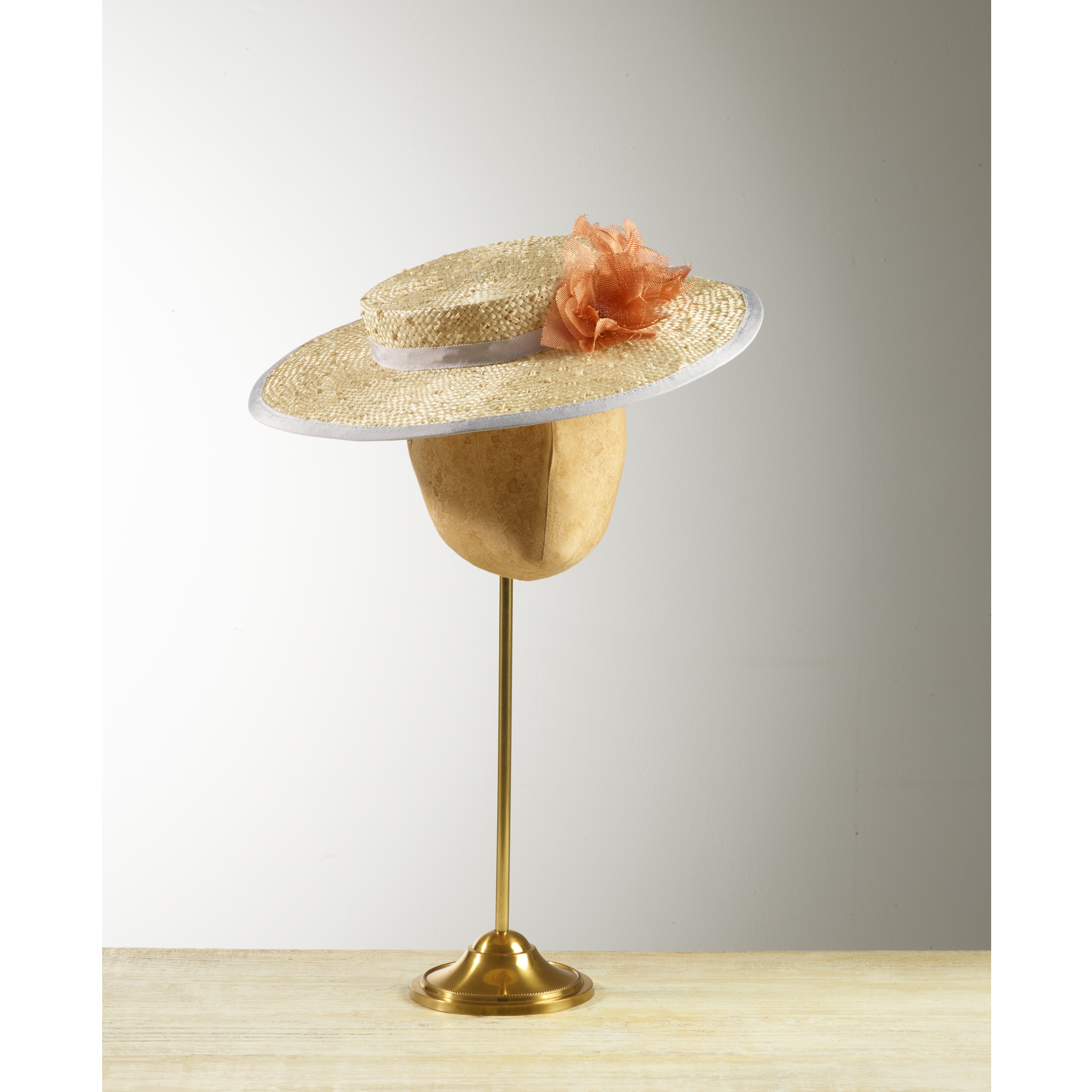 STOWAWAY - £85  Cream knotted sisal straw boater with silvery lilac trim and mesh copper flowers.