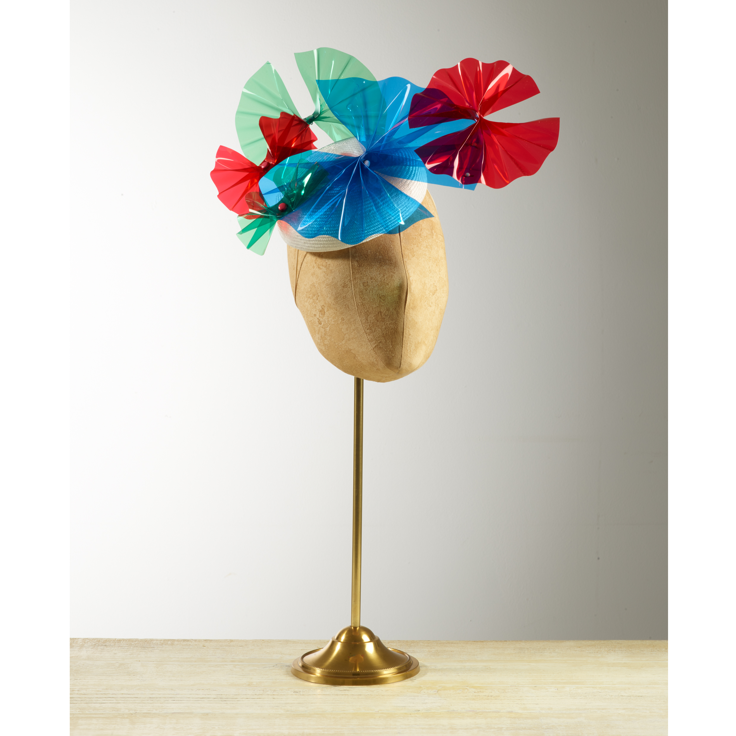 PALM (Blue/Red/Green) - £75  White sisal straw button headpiece with blue, red and green acetate palm fronds.