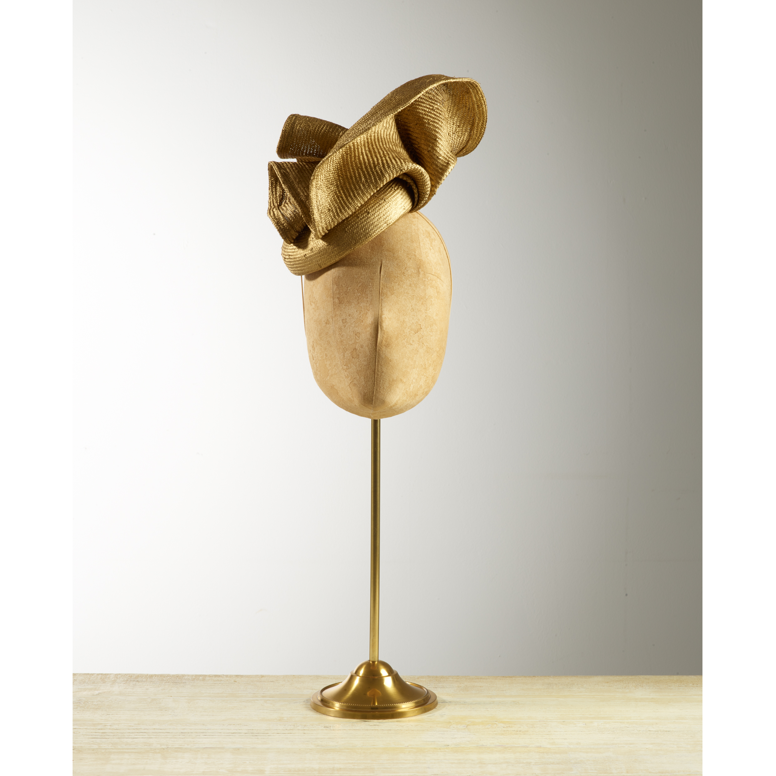 VOLUTE (Gold) - £80  Gold sisal straw button headpiece with matching structural folds.