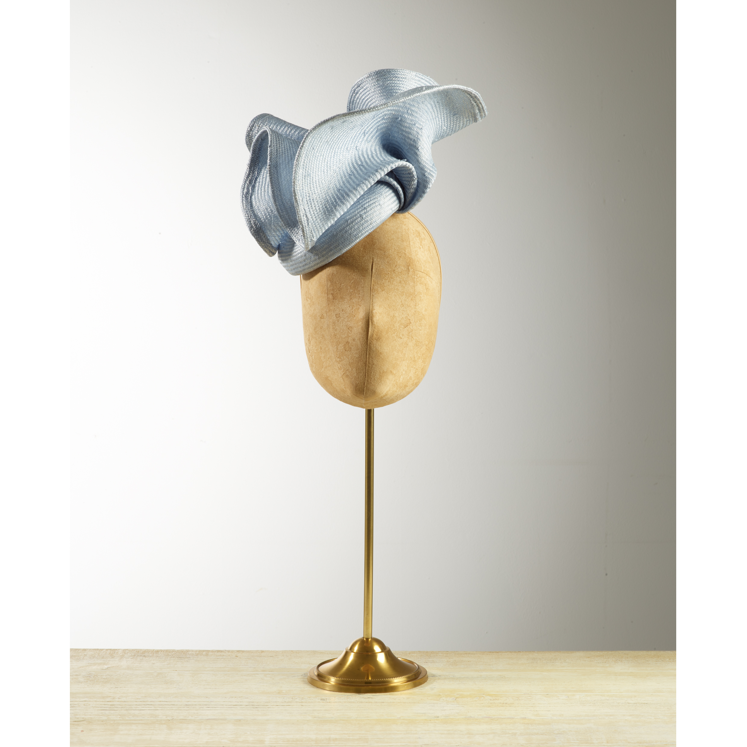 VOLUTE (Pale Blue) - £80  Pale blue sisal straw button headpiece with matching structural folds.