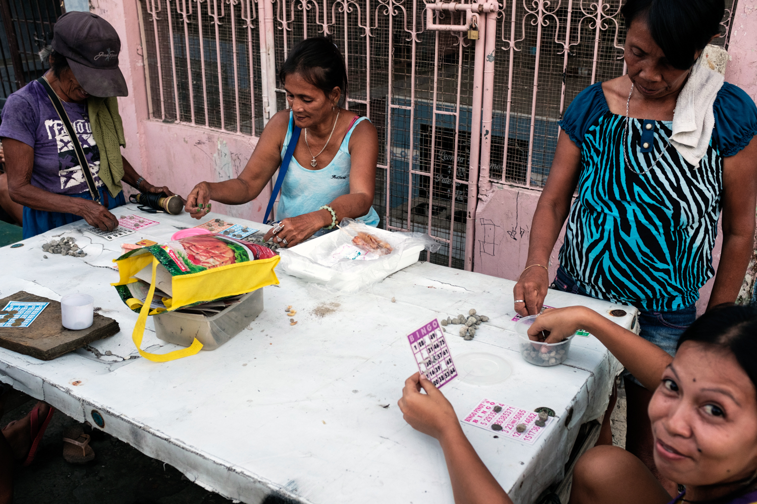 Women play bingo at the Carreta Cemetery where, they also live.
