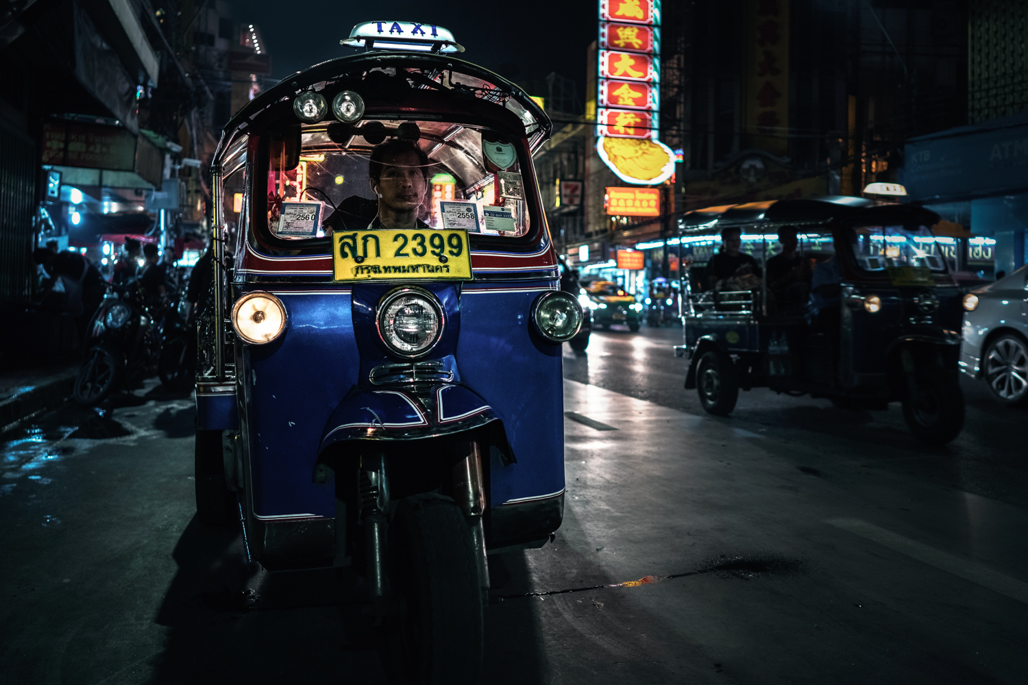 A tuk tuk driver waits for passengers in Chinatown.