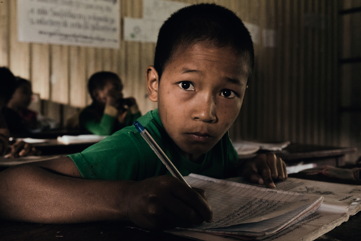 A young boy in this remote village school.